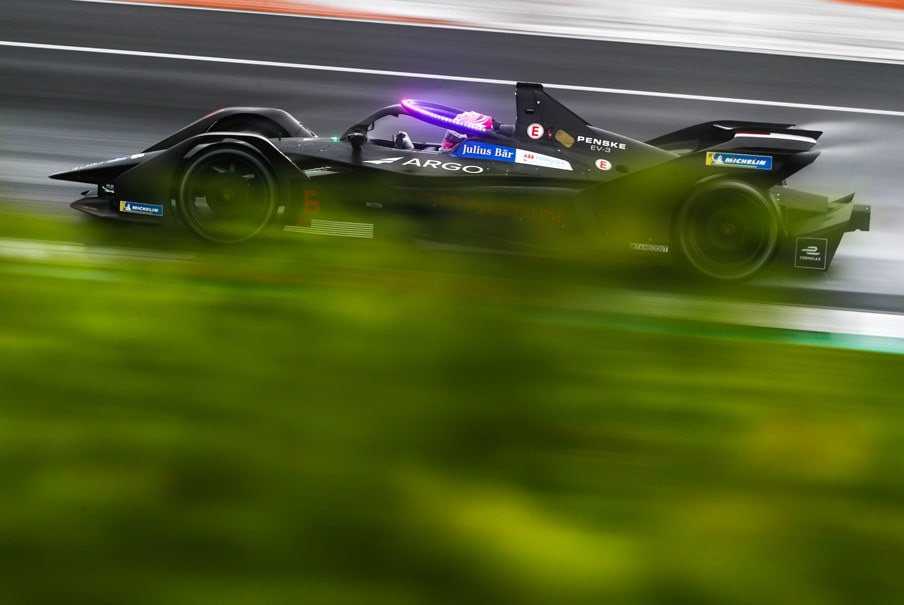 a Formula E Generation two electric racing car with purple lights on indicating that 'attack mode' is activated