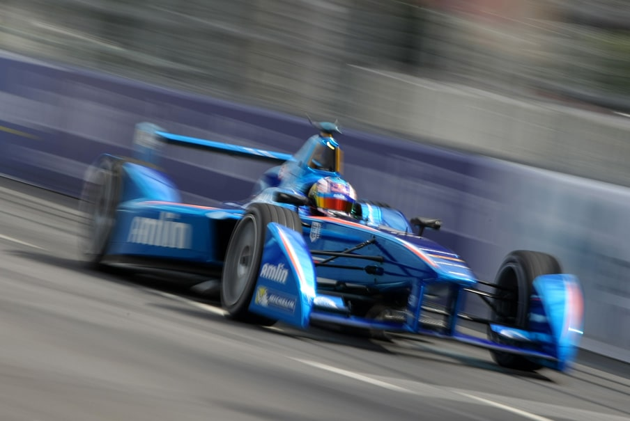 a Formula E electric racing car speeding on the track