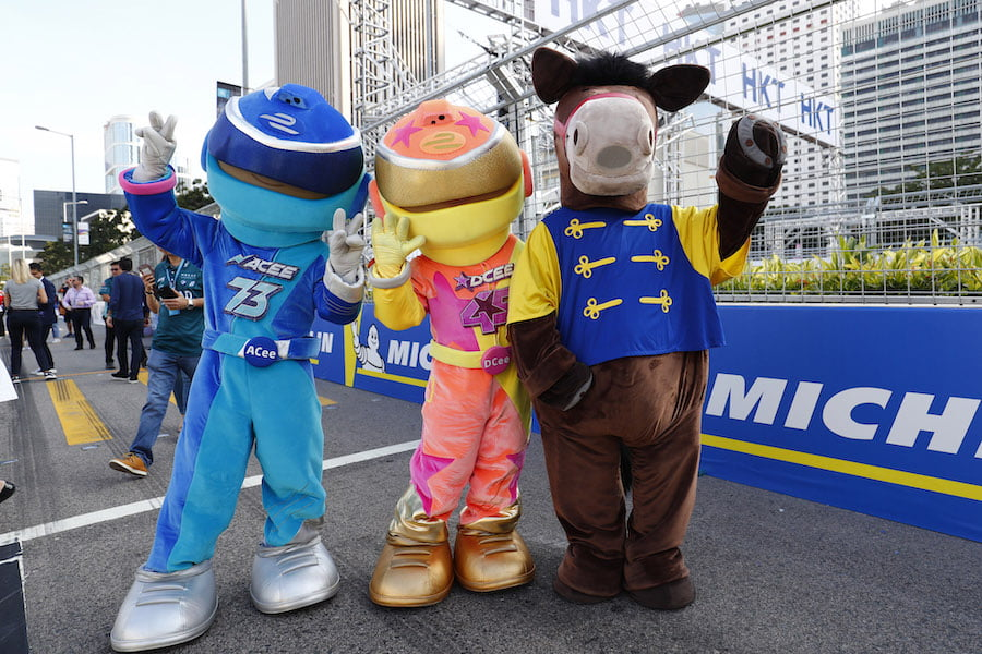 mascot characters entertain the crowd at the Formula E E-prix