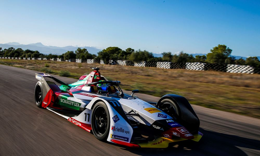 a Formula E racing car drives round a track during a test in Mallorca