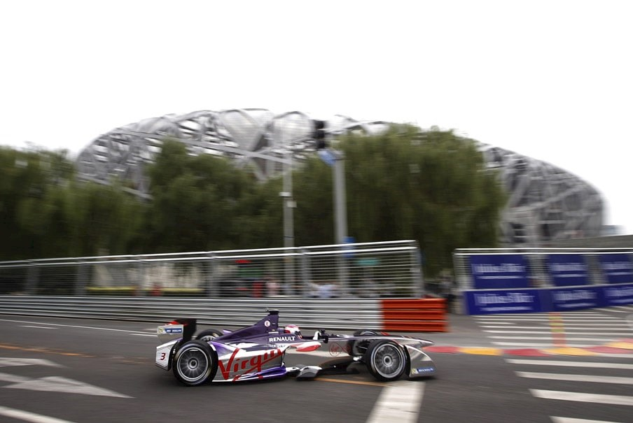a first generation Formula E electric racing car on a track in China