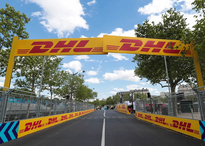 a Formula E racing track with DHL branding