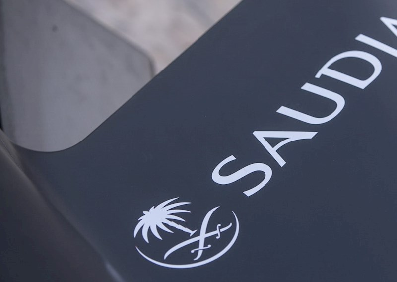 the logo of Saudi airline SAUDIA on the side of a Formula E racing car