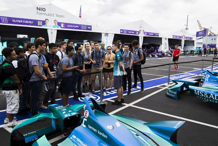 fans listen to a talk about Formula E cars
