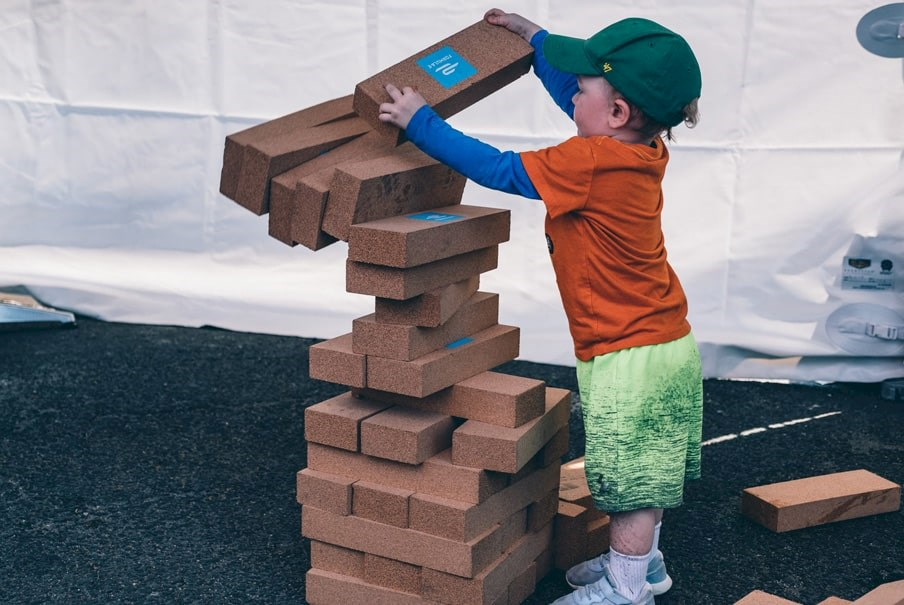 a child plays at the Allianz E-Village at a Formula E event