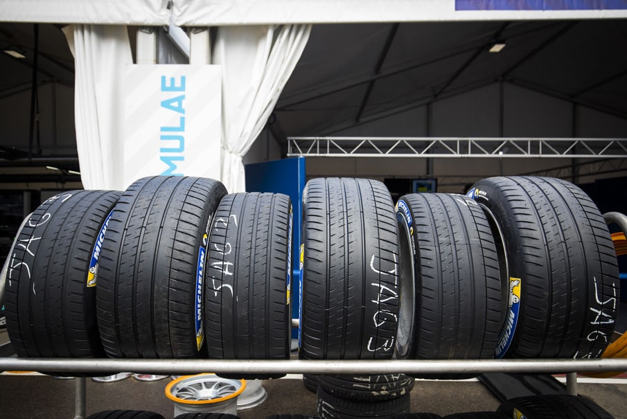 a rack holding Michelin tyres at a Formula E pit lane