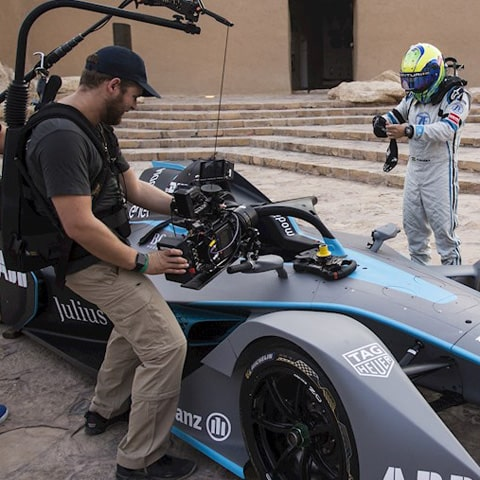 formula e ways to watch - a film crew records a formula e driver